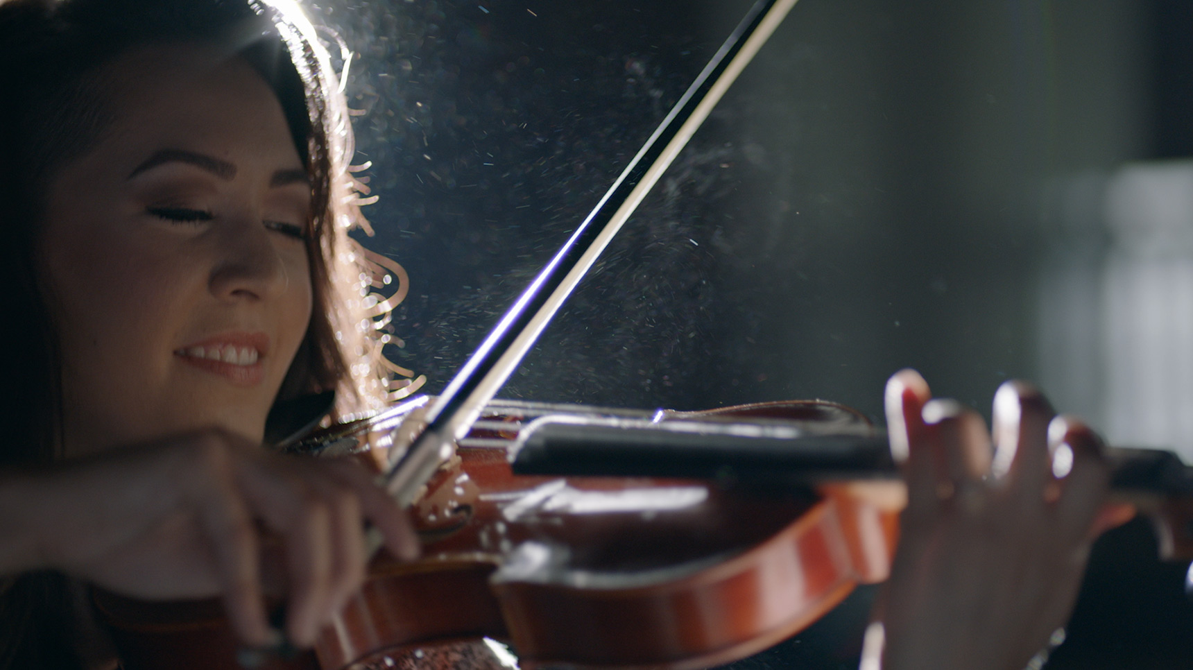 a woman plays the violin